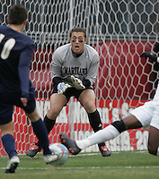 DEC 3, 2005: College Park MD, USA: Maryland Terrapins goalkeeper (0) Chris Seitz keeps his eye on the ball as Akron Zips midfielder (10) Sinisa Ubiparipovic has his shot blocked by Maryland Terrapins midfielder (10) Maurice Edu at Ludwig Field. Mandatory Credit: Photo By Brad Smith-International Sports Images (c) Copyright 2005 Brad Smith