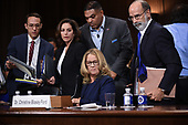 Christine Blasey Ford (C, seated), the woman accusing Supreme Court nominee Brett Kavanaugh of sexually assaulting her at a party 36 years ago, testifies before the US Senate Judiciary Committee on Capitol Hill in Washington, DC, September 27, 2018.  / POOL / SAUL LOEB
