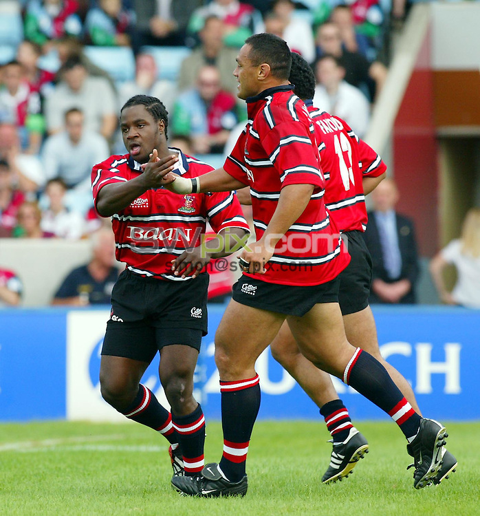 Pix: Rob Matthews/SWpix.com.  Rugby Union. Zurich Premiership. Harlequins v Gloucester. 31/08/2002...COPYRIGHT PICTURE>>SIMON WILKINSON>>01943 436649>>..Gloucester's Marcel Garvey is congratulated by team mates Junior Paramore and Terry Fanolua.