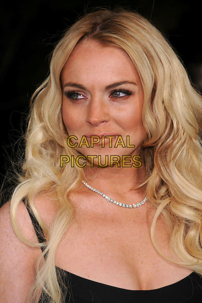 "LINDSAY LOHAN.""Cloverfield"" Los Angeles Premiere at Paramount Studios, Hollywood, California, USA..January 16th, 2008 .headshot portrait diamond necklace .CAP/ADM/BP.©Byron Purvis/AdMedia/Capital Pictures."
