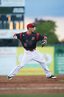 Batavia Muckdogs third baseman Tyler Curtis (11) throws to first for the out in the top of the fifth inning during a game against the West Virginia Black Bears on June 26, 2017 at Dwyer Stadium in Batavia, New York.  Batavia defeated West Virginia 1-0 in ten innings.  (Mike Janes/Four Seam Images)