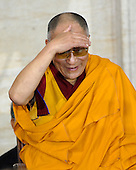 Washington, DC - October 17, 2007 -- The 14th Dalai Lama, Tenzin Gyatso, shields his eyes to look out over the audience at The Capitol in Washington, D.C. on Wednesday, October 17, 2007.  The Dalai Lama was at The Capitol to accept the Congressional Gold Medal, the nation's highest and most distinguished civilian award..Credit: Ron Sachs/CNP