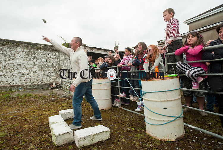 Wayne Tapper competing during the World Stone Throwing Championships as party of the Festival of Finn at Corofin. Photograph by John Kelly.