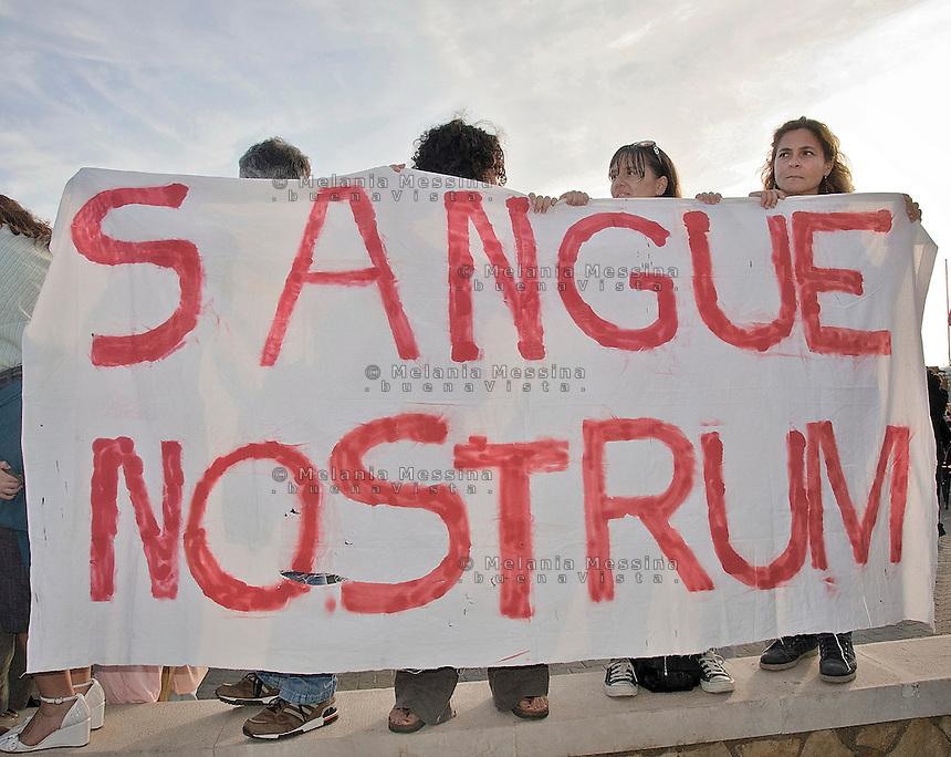 Agrigento, proteste durante i funerali di stato per i morti a Lampedusa.<br /> Agrigento,protest during  state funerals for the victims in Lampedusa