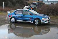 Barry Groundwater - Neil Shanks in a Mitsubishi Lancer Evolution 9 at the Noise Test which took place at the Tulloch Stadium, Inverness for the 2014 Arnold Clark/Thistle Hotel Snowman Rally supported by Highland Office Equipment, part of the Capital Document Solutions which was organised by Highland Car Club and based in Inverness on 22.2.14; Round 1 of the 2014 RAC MSA Scottish Rally Championship sponsored by ARR Craib Transport Limited.