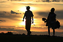 Ross Fisher (ENG) walks up the 18th hole with his caddie at daybreak to complete his third round of the Portugal Masters played at Victoria Course on 19th October 2008 in Vilamoura, Portugal....