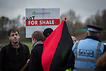 © Joel Goodman - 07973 332324 . No syndication permitted . 27/11/2013 . Manchester , UK . Protesters at the site . Energy firm IGas have today (Wednesday 27th November 2013) been receiving drilling equipment in readiness for exploratory drilling at the site . Anti fracking protesters have established a camp at Barton Moss in Greater Manchester alongside an access road leading to an IGas drilling site .  Photo credit : Joel Goodman