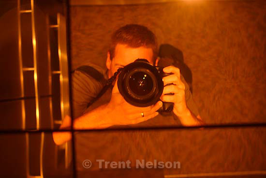 trent nelson in mirror, elevator mirror, gateway discovery; 8.26.2006<br />
