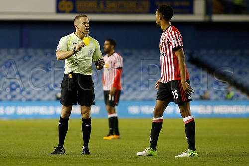 August 16th 2017, Hillsborough, Sheffield, England; EFL Championship Football, Sheffield Wednesday versus Sunderland; Sunderlands Brendan Galloway slides in on Sheffield Wednesdays Jack Hunt and is shown a yellow card