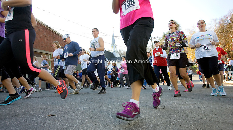 THOMASTON, CT. 11 November 2012-111112SV12-Runners take off during at the start of the 11th annual running of the Dianne Burr Memorial 5K in Thomaston Sunday. The event raised money for a local girl who is in treatment for cancer. Mike Burr, an organizer of the event that is named for his late wife, said the race committee this year has decided to donate the proceeds to the family of 11-year-old Madison McCarthy, a sixth-grade student at Center School who was diagnosed with Hodgkin's Lymphoma earlier this year..Steven Valenti Republican-American