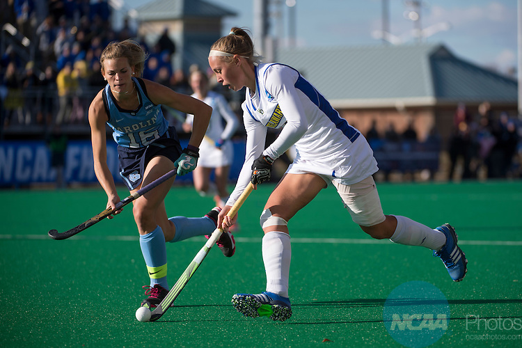 NORFOLK, VA - NOVEMBER 20:  Lisa Giezeman (11) of the University of Delaware races past Julia Young (16) of the University of North Carolina during the Division I Women's Field Hockey Championship held at the LR Hill Sports Complex on November 20, 2016 in Norfolk, Virginia.  Delaware defeated North Carolina 3-2 for the national title. (Photo by Jamie Schwaberow/NCAA Photos via Getty Images)