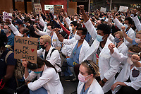 NEW YORK, NEW YORK - JUNE 2: Front line medical workers protest against the death of George Floyd on June 2, 2020 in New York. The protests spread across the country in at least 30 cities across the United States, over the death of unarmed black man George Floyd at the hands of a police officer, this is the latest death in a series of police deaths of black Americans. (Photo by Stephen Ferry /VIEWpress via Getty Images)