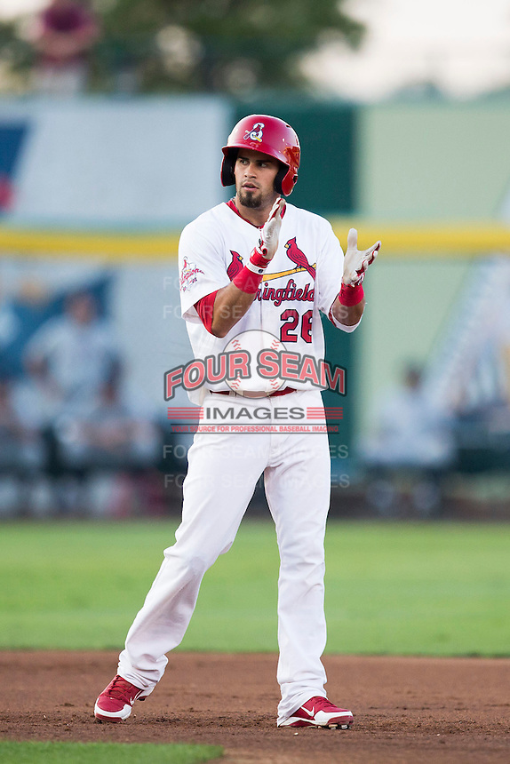 Luis Mateo (26) of the Springfield Cardinals claps his hands after hitting an RBI double during a game against the Northwest Arkansas Naturals at Hammons Field on August 20, 2013 in Springfield, Missouri. (David Welker/Four Seam Images)