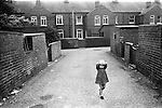 South Kirkby Colliery Yorkshire England. 1979. Back alley between back to back miners housing.
