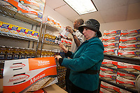 Cynthia Zalisky, Exec. Director of the Queens Jewish Community Council and volunteer Gary Smith shelve packages of matzoh in the  council's kosher food pantry in Queens in New York on Tuesday March 27, 2012. Stop & Shop supermarkets has donated one thousand pounds of kosher Passover foods to the Queens Jewish Community Council Kosher Food Pantry.  An estimated 300,000 Jewish households live in impoverished conditions and throughout the year and the pantry provided food in February 2012 for 1,560 Queens residents, an increase of 68 percent from February 2009. (© Richard B. Levine)