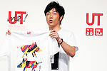 """Actor and comedian Tomonori Jinnai attends a special Uniqlo media event to promote the """"UTme!"""" smart phone application on April 28, 2015. The application allows customers to upload their own designs to sell through """"UTme! Market"""". Customers also can select new effects, characters and designs from Coca-Cola, Mottchy the Kakkoii-inu and fashion magazine Non-no. (Photo by Rodrigo Reyes Marin/AFLO)"""