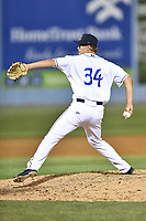 Asheville Tourists pitcher J.D. Hammer (34) delivers a pitch during a game against the Greensboro Grasshoppers at McCormick Field on April 28, 2017 in Asheville, North Carolina. The Grasshoppers defeated the Tourists 3-2. (Tony Farlow/Four Seam Images)