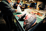 A man buys blue fin tuna at a retailer inside Tsukij fish market in Tokyo, Japan on 30 March  2009.