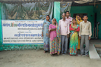 Jeevika Field Associates pose for a group photograph together with collection centre workers and producer group farmers at the collection centre in Machahi village, Muzaffarpur, Bihar, India on October 27th, 2016. Non-profit organisation Technoserve works with women vegetable farmers in Muzaffarpur, providing technical support in forward linkage, streamlining their business models and linking them directly to an international market through Electronic Trading Platforms. Photograph by Suzanne Lee for Technoserve