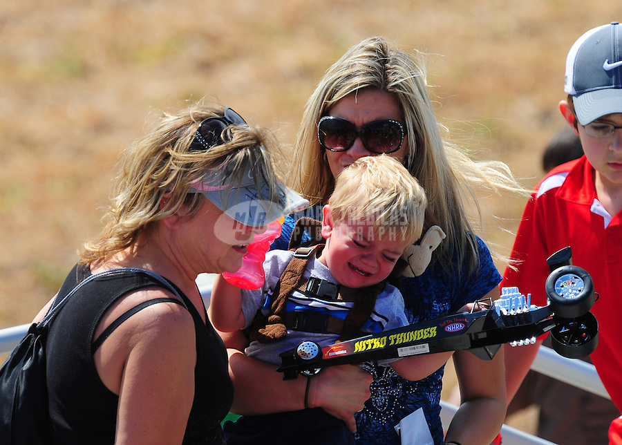 Sept. 24, 2011; Ennis, TX, USA: NHRA fans in the grandstands during qualifying for the Fall Nationals at the Texas Motorplex. Mandatory Credit: Mark J. Rebilas-