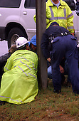 """Fredericksburg, VA - October 11, 2002 -- Spotsylvania County Police search the scene along Route 1 near I-95 where a man was shot and killed at an Exxon Station this morning.  Police have not determined if this shooting is connected with the """"Beltway Sniper"""" shootings that have terrorized the NationalCapital Area.<br /> Credit: Ron Sachs / CNP<br /> (RESTRICTION: NO New York or New Jersey Newspapers or newspapers within a 75 mile radius of New York City)"""