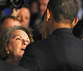 Elkhart, IN - February 9, 2009 -- A woman looks up at United States President Barack Obama as she speaks to him after he addressed a town hall meeting in Elkhart, Indiana, USA 09 February 2009. Obama is seeking public support for his economic stimulus plan by taking to the road to visit hard hit areas of the country. The unemployment rate in Elkhart is over 15%, triple the rate of December 2008..Credit: Tannen Maury - Pool via CNP.