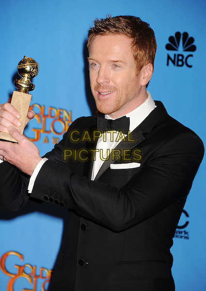 Damian Lewis.Press Room at the 70th Annual Golden Globe Awards held at the Beverly Hilton Hotel, Hollywood, California, USA..January 13th, 2013.globes half length shirt black white bow tie tuxedo award trophy winner stubble facial hair .CAP/GAG.©GAG/Capital Pictures