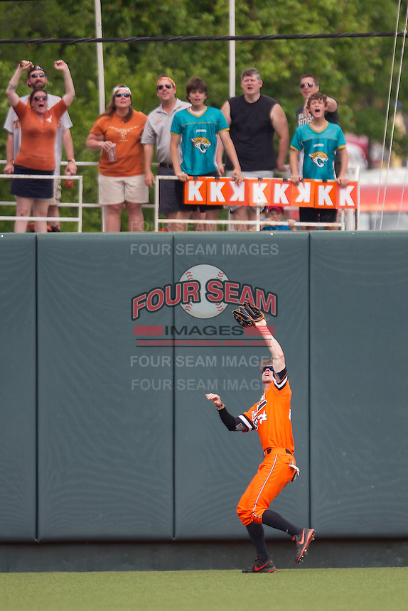 Oklahoma State Cowboys outfielder Conor Costello #24 records the final out of theNCAA baseball game against the Texas Longhorns on April 26, 2014 at UFCU Disch–Falk Field in Austin, Texas. The Cowboys defeated the Longhorns 2-1. (Andrew Woolley/Four Seam Images)