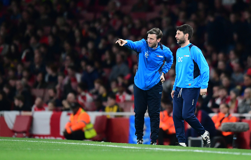 Lincoln City's assistant manager Nicky Cowley, left, and Lincoln City manager Danny Cowley shouts instructions to their team from the dug-out<br /> <br /> Photographer Chris Vaughan/CameraSport<br /> <br /> The Emirates FA Cup Quarter-Final - Arsenal v Lincoln City - Saturday 11th March 2017 - The Emirates - London<br />  <br /> World Copyright &copy; 2017 CameraSport. All rights reserved. 43 Linden Ave. Countesthorpe. Leicester. England. LE8 5PG - Tel: +44 (0) 116 277 4147 - admin@camerasport.com - www.camerasport.com