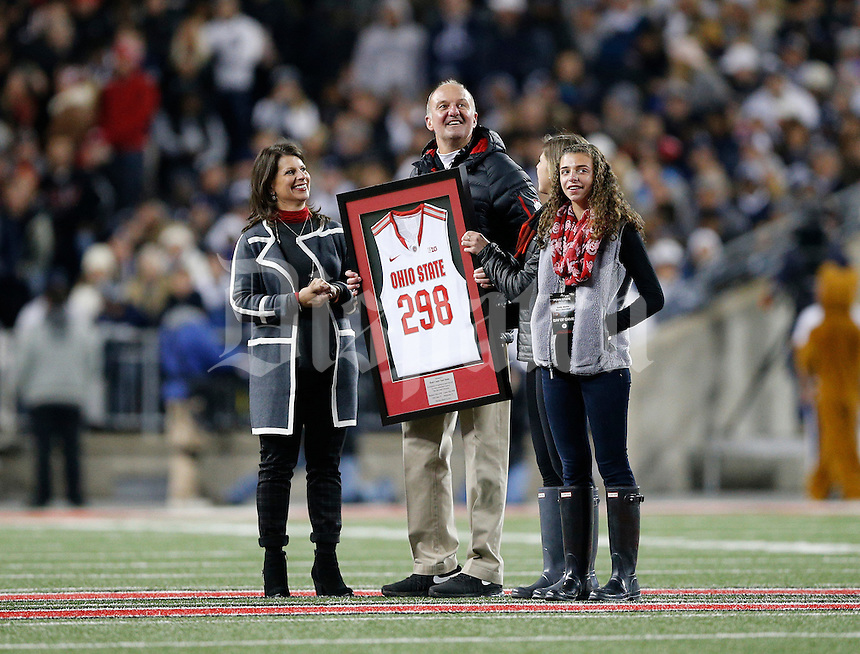 Ohio State basketball head coach Thad Matta is recognized at midfield with his family for becoming the winningest coach in school history during the NCAA football game against the Penn State Nittany Lions at Ohio Stadium in Columbus on Oct. 17, 2015. (Adam Cairns / The Columbus Dispatch)