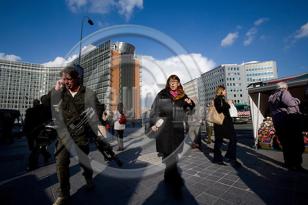 BRUSSELS - BELGIUM - 28 OCTOBER 2008 -- Danish Radio and TV correspondent Mette FUGL walking at Round Point Schuman with her back towards Berlaymont, The European Commission. On the left her cameraman Joseph BACKES. Photo: Erik Luntang/EUP-IMAGES