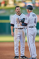 Matt Szczur (8) of the Reno Aces talks with coach Greg Gross (4) during the game against the Nashville Sounds at Greater Nevada Field on June 5, 2019 in Reno, Nevada. The Aces defeated the Sounds 3-2. (Stephen Smith/Four Seam Images)