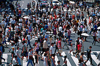 Aerial view of Japanese pedestrians at a busy city intersection. Tokyo, Shibuya district, Japan.