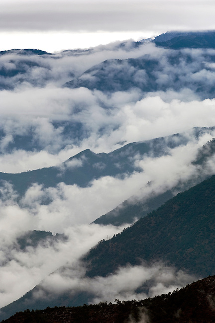 Interlacing hills and clouds along Yangtse, Jingsha, River, China
