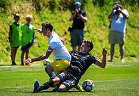 Liam Wood and Louis Fenton compete for the ball the ISPS Handa Premiership football match between Team Wellington and Wellington Phoenix Reserves at David Farrington Park in Wellington, New Zealand on Sunday, 7 January 2018. Photo: Dave Lintott / lintottphoto.co.nz