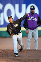May 3, 2010:  Starting pitcher Aroldis Chapman (51) of the Louisville Bats warms up in the bullpen as coach Ted Power looks on prior to a game vs. the Buffalo Bisons at Coca-Cola Field in Buffalo, NY.   Louisville defeated Buffalo by the score of 20-7, Chapman got the win on the mound.  Photo By Mike Janes/Four Seam Images