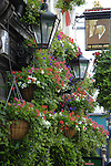 Hanging flower baskets on exterior of Churchill Arms pub in Notting Hill, London