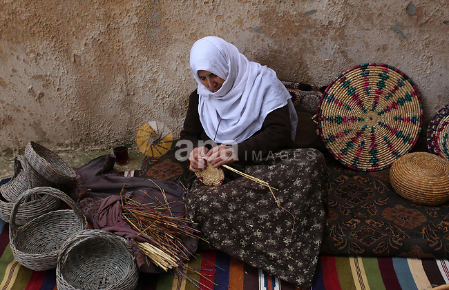 Mariyam Haj Ali, 86-year-old Palestinian woman, makes trays and baskets using wheat and olive straws, at her home in the village of Jama'in near the West Bank city of Nablus, on February 27 2019. Photo by Shadi Jarar'ah