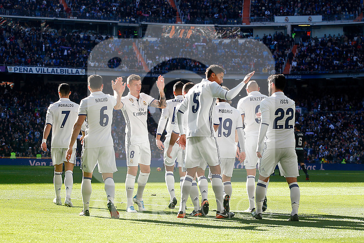 Real Madrid's Cristiano Ronaldo, Toni Kroos, Raphael Varane, Carlos Henrique Casemiro, Daniel Carvajal, Nacho Fernandez, Luka Modric, Isco Alarcon and Karim Benzema celebrate goal during La Liga match. January 7,2016. (ALTERPHOTOS/Acero)