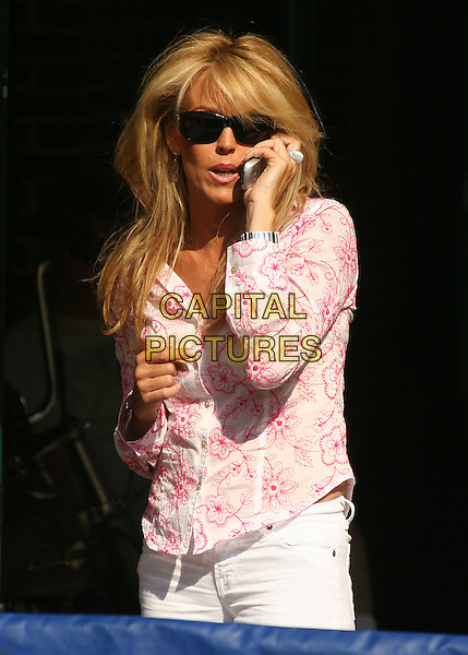 DIANA LOHAN.at ''The Late Show with David Letterman''.Ed Sullivan Theatre,.New York City, NY, USA,.June 21, 2005..half length mother of Lindsay Lohan mom mum black sunglasses talking on mobile phone.Ref: IW.www.capitalpictures.com.sales@capitalpictures.com.©Ian Wilson/Capital Pictures.