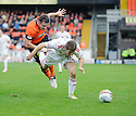 Aberdeen's Ryan Fraser goes down under a challenge from United's Keith Watson  ...