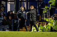 Wycombe Wanderers Manager Gareth Ainsworth asks the fourth official Matt Eva about the 6 minutes of added on time during the FA Cup 1st round match between Portsmouth and Wycombe Wanderers at Fratton Park, Portsmouth, England on the 5th November 2016. Photo by Liam McAvoy.