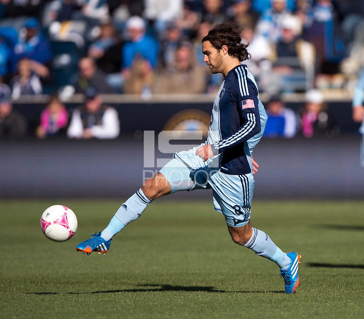 Graham Zusi (8) of Sporting Kansas City passes the ball forward during a Major League Soccer game at PPL Park in Chester, PA. Sporting Kansas City defeated the Philadelphia Union, 2-1.