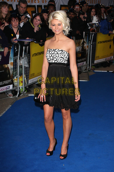 Danielle Harold.'The Adventures of Tintin: The Secret of the Unicorn' UK film premiere, 55th BFI London Film Festival, Odeon West End cinema, Leicester Square, London, England..23rd October 2011.LFF full length black white print strapless dress clutch bag side.CAP/ROS.©Steve Ross/Capital Pictures