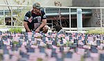 Michael Fialkowski and his dog Schultz participate in the 4th annual Veterans Suicide Awareness March at Western Nevada College, in Carson City, Nev., on Saturday, May 5, 2018. More than 8,000 American flags are planted at the campus to symbolize the number of veteran suicides each year in the U.S. <br />