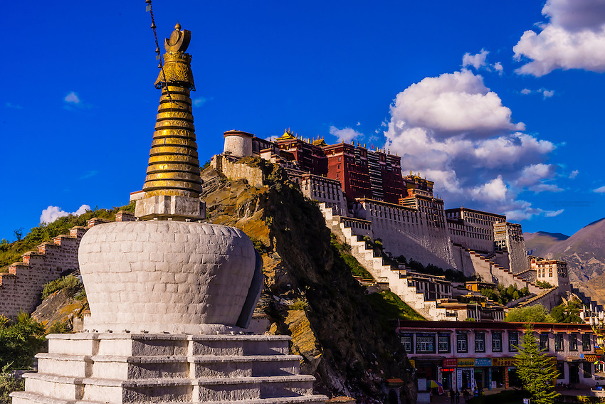 The Potala Palace (a UNESCO World Heritage Site) with stupas in front. It was the chief residence of the Dalai Lama until the 14th Dalai Lama fled to Dharamsala, India, during the 1959 Tibetan uprising. The massive palace contains 999 rooms. Lhasa, Tibet, China.