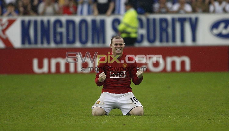 PICTURE BY Ben Duffy/SWPIX.COM -Premier League Football, Wigan Athletic v Manchester United....11/05/08. ..Copyright - Simon Wilkinson - 07811267706..Manchester United's Wayne Rooney celebrates winning the title at Wigan