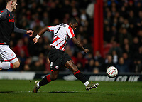 4th January 2020; Griffin Park, London, England; English FA Cup Football, Brentford FC versus Stoke City; Dru Yearwood of Brentford taking a shot on goal - Strictly Editorial Use Only. No use with unauthorized audio, video, data, fixture lists, club/league logos or 'live' services. Online in-match use limited to 120 images, no video emulation. No use in betting, games or single club/league/player publications