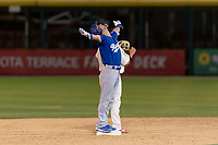 Rancho Cucamonga Quakes second baseman Brandon Montgomery (12) celebrates after getting his first hit of the season during a California League game against the Visalia Rawhide on April 9, 2019 in Visalia, California. Visalia defeated Rancho Cucamonga 8-5. (Zachary Lucy/Four Seam Images)