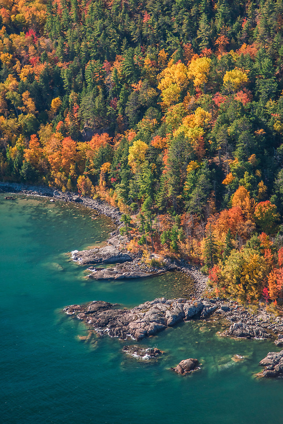 Aerial photography of the rugged Lake Superior shoreline north of Marquette, Michigan during fall color season. Areas shown include Wetmore Landing.